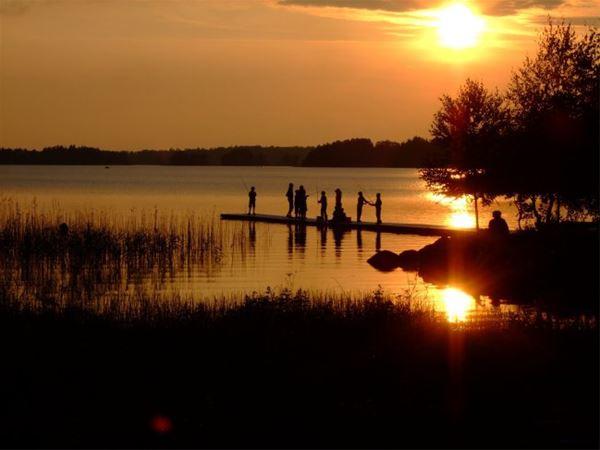 Schmeier,  © Mjölknabbens Camping, Solnedgång öven Åsnen