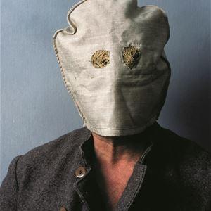 © Sveriges Fängelsemuseum, man i ansiktsmask av tyg