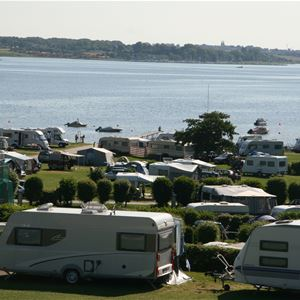 Universepackage for 4 persons at Lærkelunden Camping in own caravan, motorhome or tent