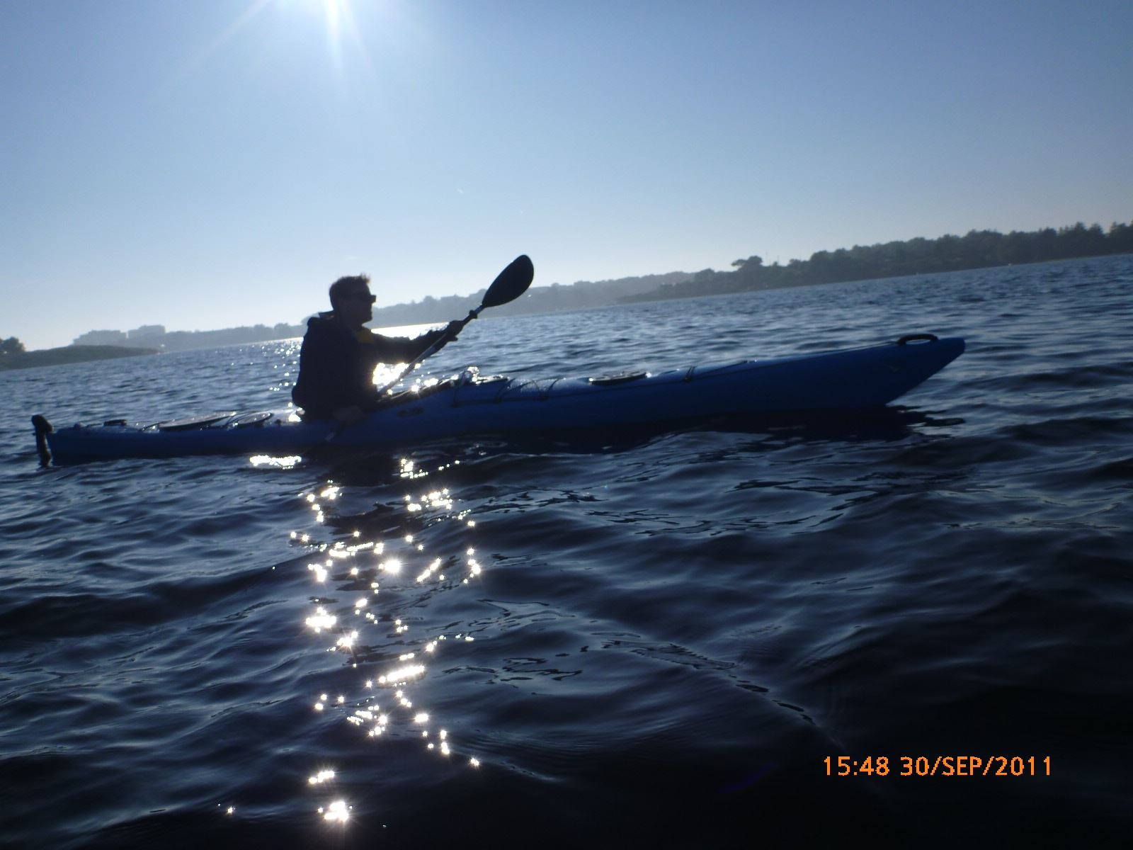 Kayaking in the archipelago of Karlskrona and grilled food at dusk