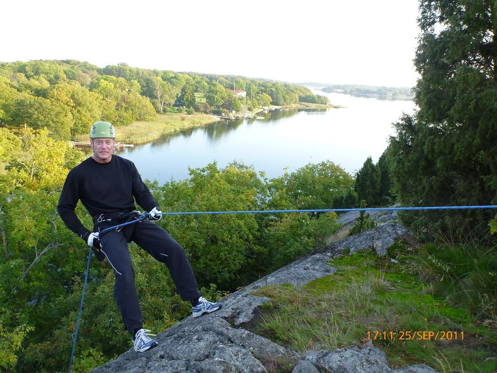 Rappelling from a 30m cliff in the archipelago and grilling at dusk.