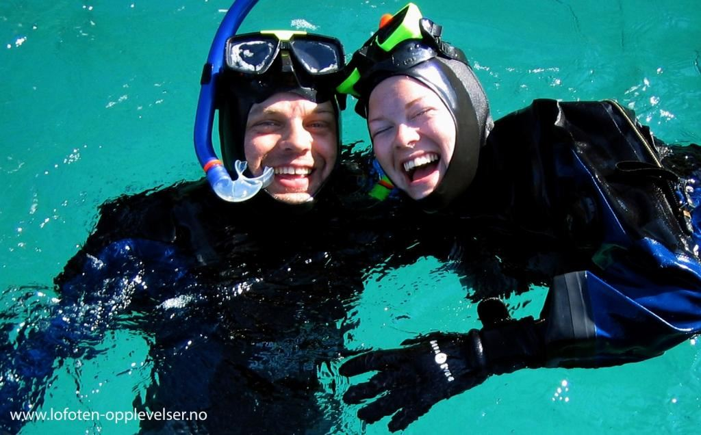 Experiencing snorkelling in crystal clear arctic waters