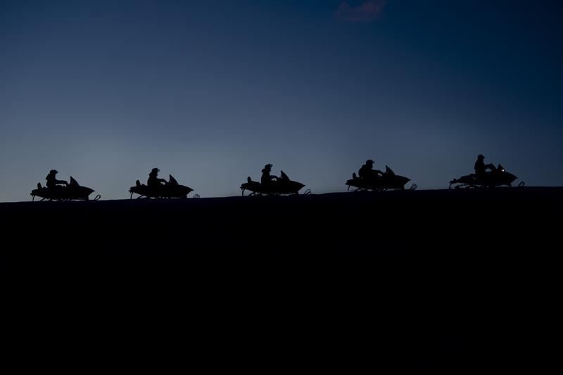 Evening safari on snowmobile/hunting for the Northern Lights