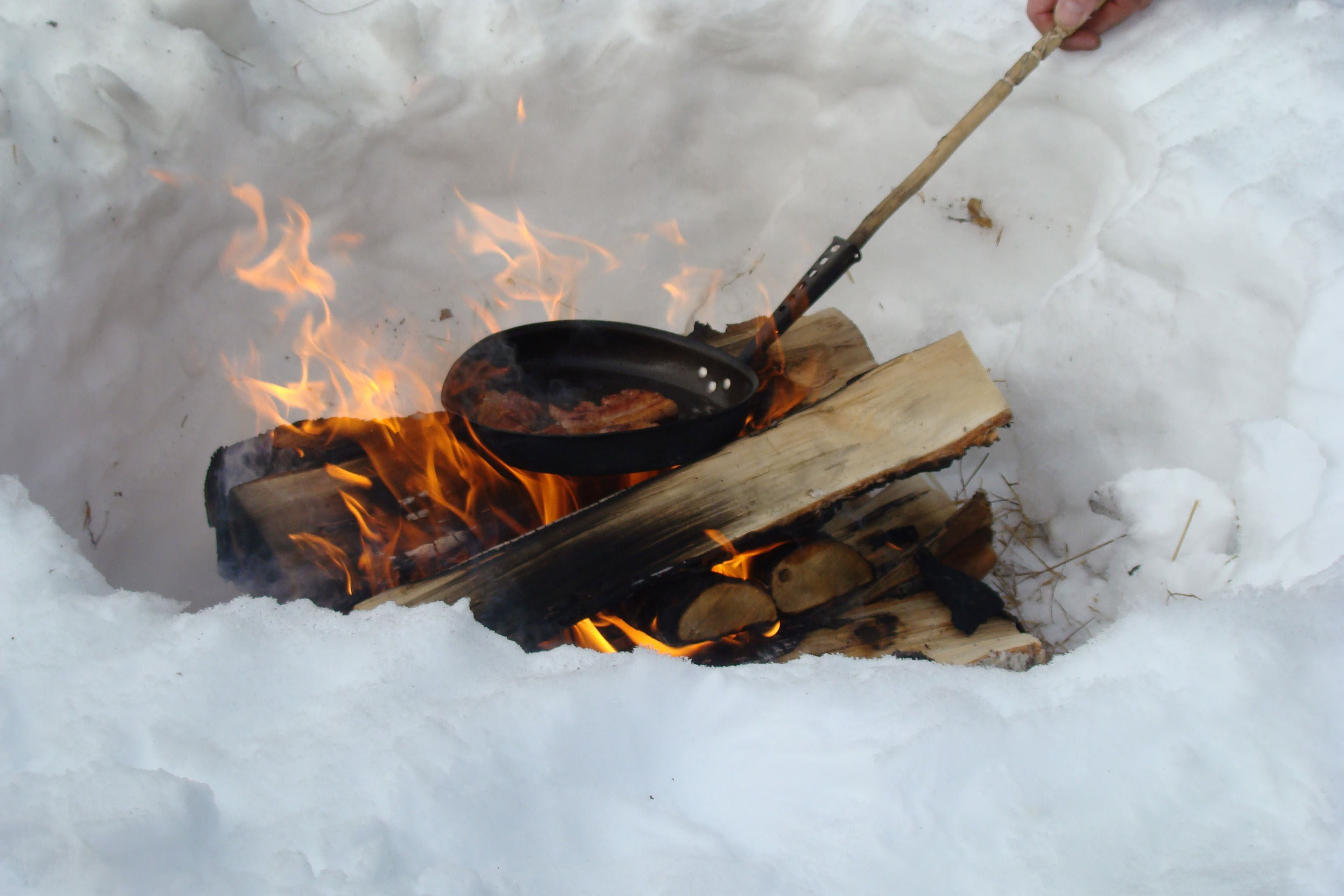 Cooking food over the fire in the Swedish part of Lapland