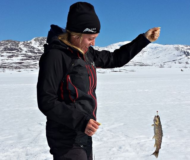 Ice fishing with guide and coffee