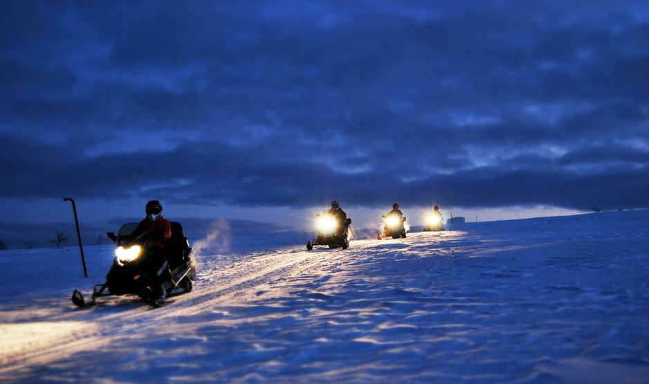 Northern lights hunt with snowmobile