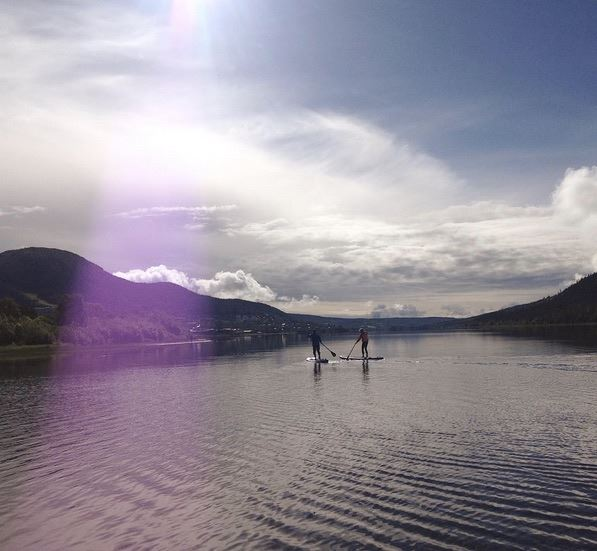 Rent your own SUP and paddle on a mountain lake