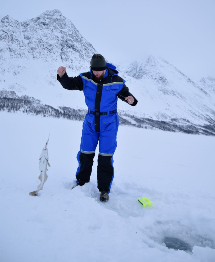 Ice fishing on the fjord in Lyngen