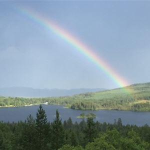 Rainbow over a lake.