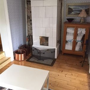 Room with tiled stove