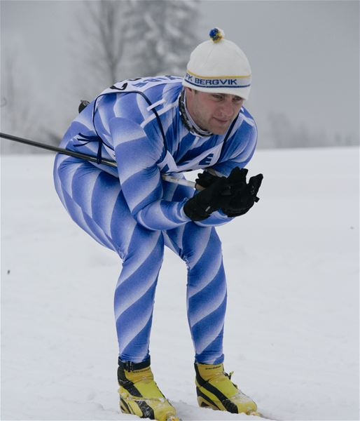 Male skier in the ski tracks.