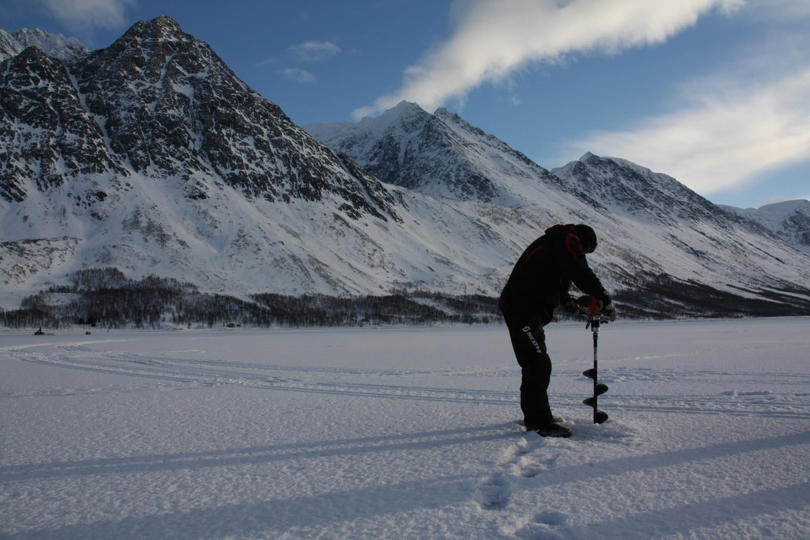 Ice fishing on the fjord in Lyngen - XLyngen