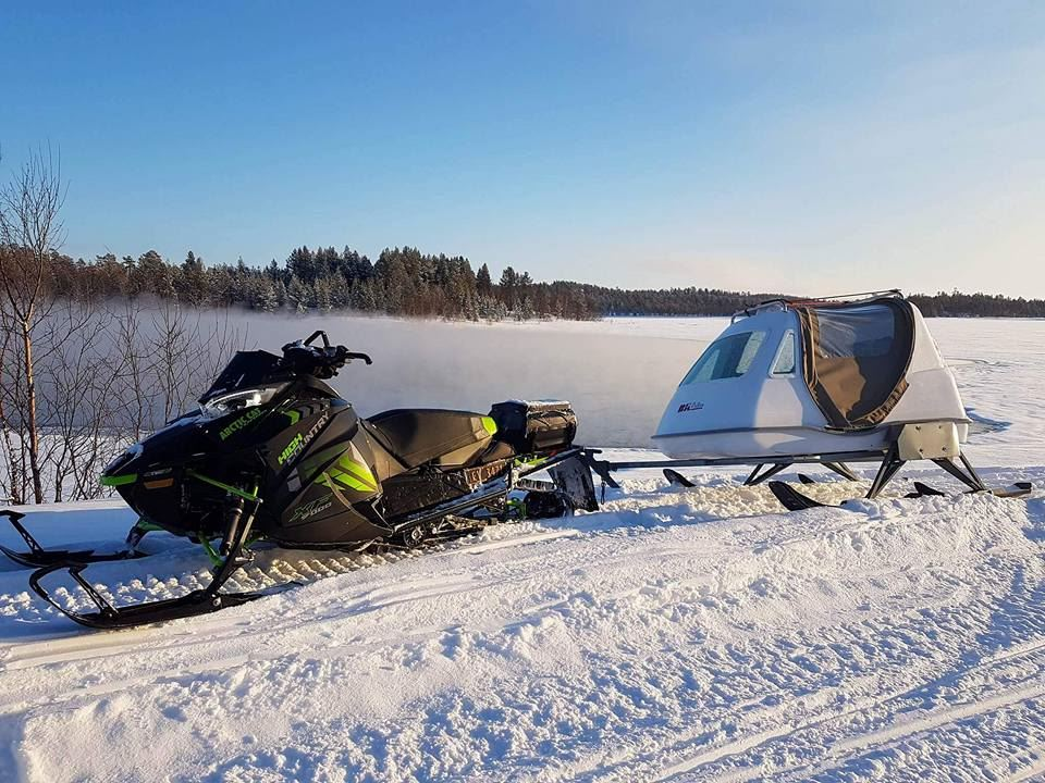 Ice fishing safari in the wilderness - with snow mobile