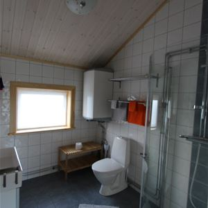 Bathroom with tiled walls and floor.