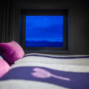 Christopher Bouvier,  © Christopher Bouvier, The room and bed with a view - Littleisland Lighthouse