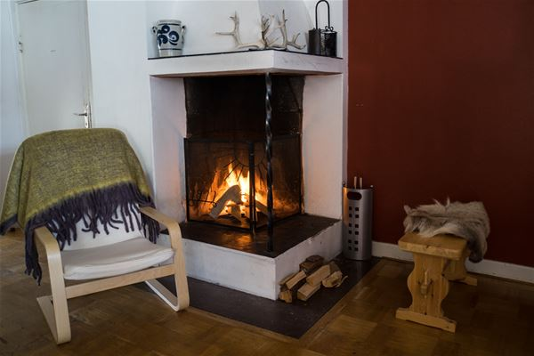 Fire place with a chair.