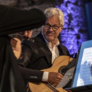 Karl Melander,  © Karl Melander, Musik i sommarkväll,:  Gitarrtoner i Börstils kyrka.