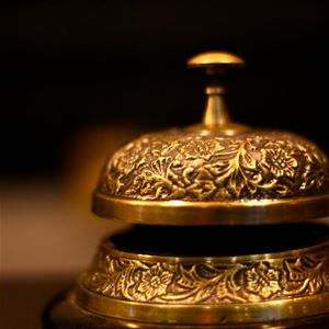 A bell on the reception desk.