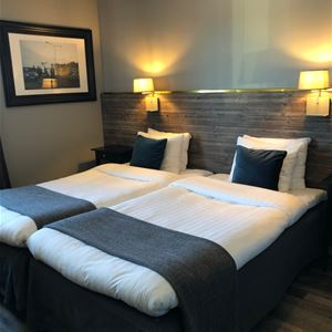 A room with a double bed.
