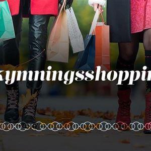 Många shoppingkassar och två par ben.