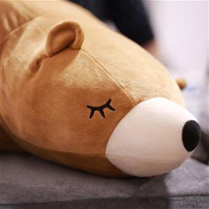 Ett gosedjur i form av en björn, ljusbrun med vit nos och stängda ögon.