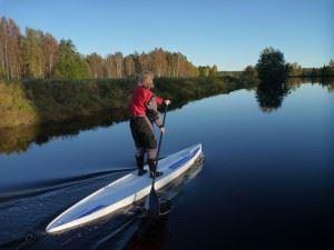 Stand up paddling med Aurora Borealis