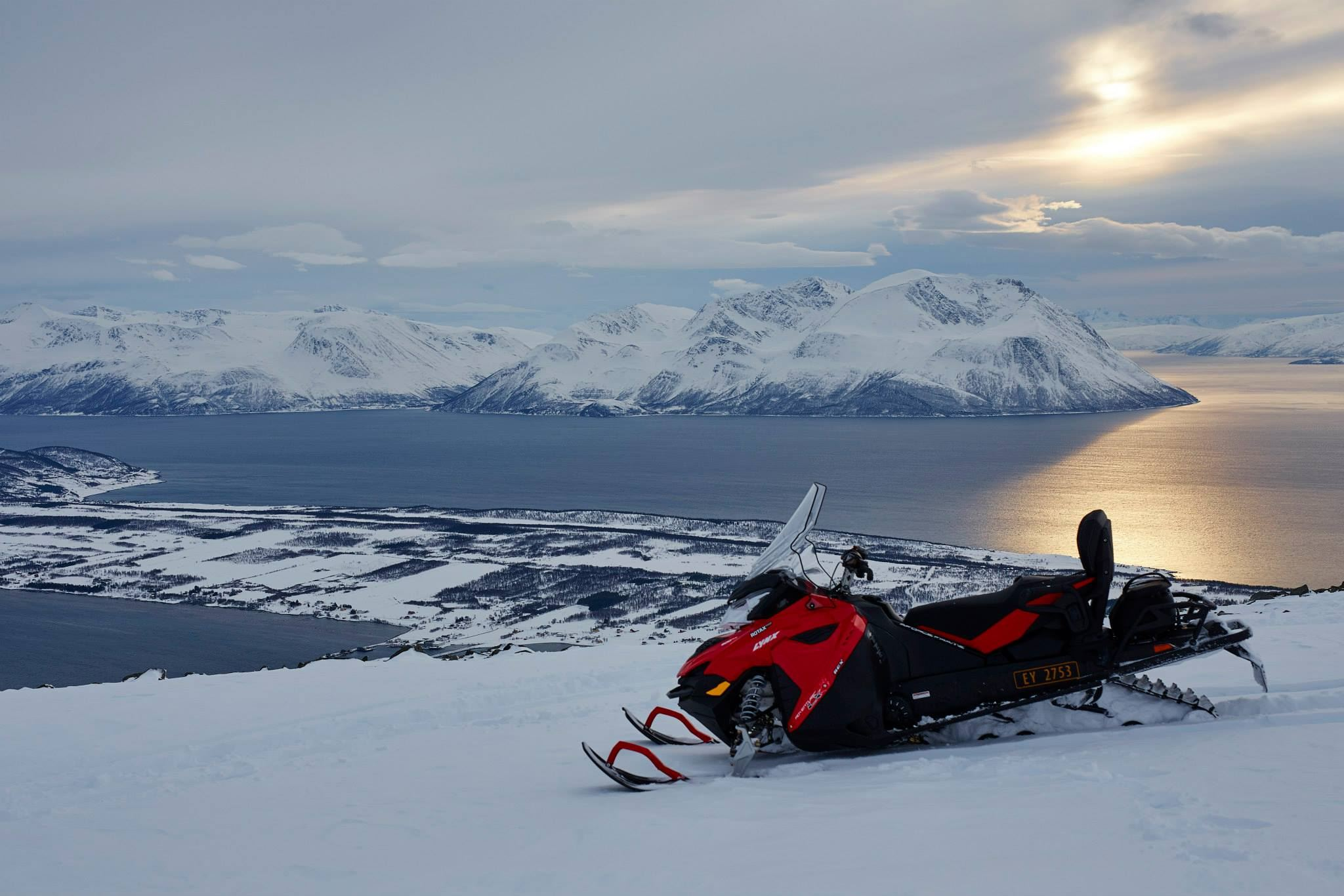 Snowmobile Safari in the Beautiful Northern Lyngen Alps - Green Gold of Norway