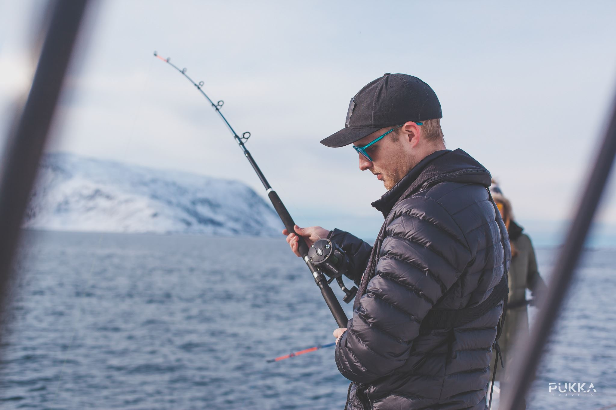 © Pukka Travels, Man fishing, snowy mountains in the background