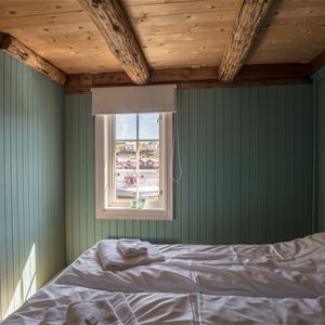 © Lofoten Rorbuhotell, Bedroom in one of the rorbu / fisherman cabins at Lofoten Rorbuhotel