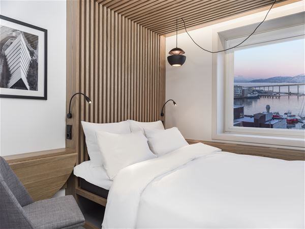 © radisson blu, a room with a view and a bed