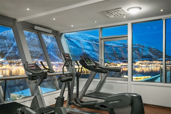 © radisson blu, a gym with treadmils and an amazing view
