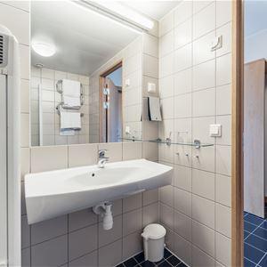 Dubbelrum med balkong och fjällutsikt på Pernilla Wiberg Hotel