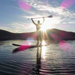 © Jæger Adventure Camp, Stand Up Paddling on a sunny day