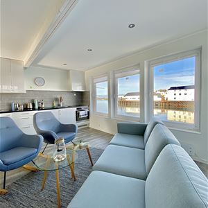Røst Bryggehotell,  © Røst Bryggehotell, Livingroom in the apartments, with a beautiful view!
