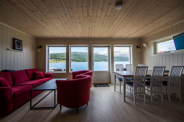 © Senja Arctic Lodge, Living and dining area with a view