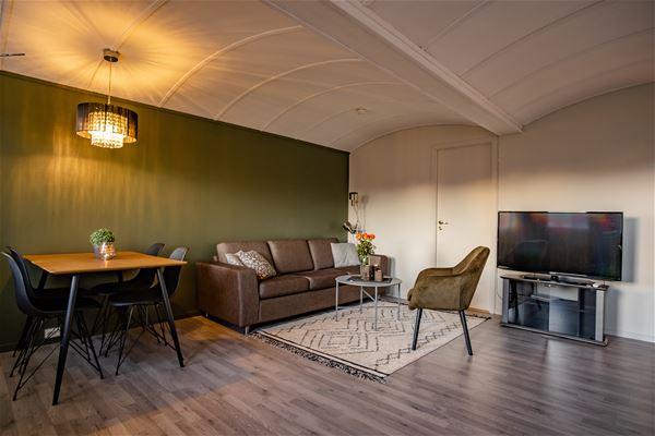 © Skagi Senja hotel & lodge, Living area in the cabin