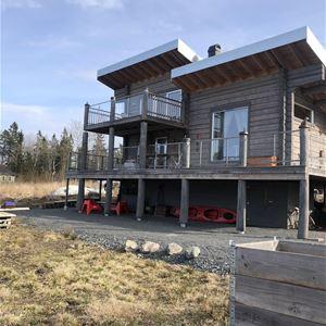 Log house in Herräng with sea views